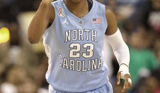 """FILE - In this March 8, 2014 file photo, North Carolina's Diamond DeShields (23) reacts after making a basket against Duke during the first half of an NCAA college basketball semifinal game at the Atlantic Coast Conference tournament in Greensboro, N.C. North Carolina coach Sylvia Hatchell says star freshman Diamond DeShields plans to transfer. In a statement Thursday, April 17, 2014, Hatchell says she doesn't know """"or understand"""" why DeShields is leaving.  (AP Photo/Chuck Burton, File)"""