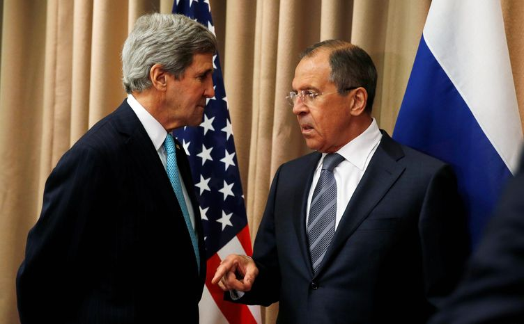 U.S. Secretary of State John Kerry, left, talks with Russian Foreign Minister Sergey Lavrov at the start of a bilateral meeting to discuss the ongoing situation in Ukraine as diplomats from the U.S., Ukraine, Russia and the European Union gather for discussions in Geneva on Thursday, April 17, 2014. (AP Photo/Jim Bourg, Pool)