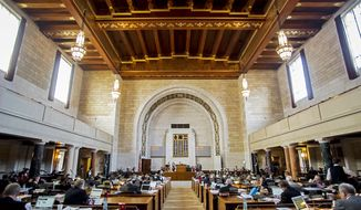 Senators take their seats and record their attendance during the final session of the 103rd Nebraska Unicameral Legislature on Thursday, April 17, 2014, at the Capitol in Lincoln, Neb. (AP Photo/Lincoln Journal Star, Kristin Streff)