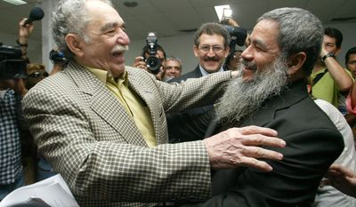 FILE - In this Dec. 16, 2005 file photo, Colombian Nobel laureate Gabriel Garcia Marquez, left, greets National Liberation Army (ELN) spokesperson Francisco Galan before a meeting between Colombia's government and the ELN in Havana, Cuba. Marquez died on Thursday, April 17, 2014 at his home in Mexico City. (AP Photo/Jorge Rey, File)