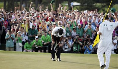 10ThingstoSeeSports - Bubba Watson's caddie Ted Scott, right, and spectators celebrate as Bubba Watson wins the Masters golf tournament Sunday, April 13, 2014, in Augusta, Ga. (AP Photo/Chris Carlson, File)