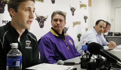 Minnesota State, Mankato defensive back Sam Thompson, left, reads a statement during a news conference as, from second from left, coach Todd Hoffener, associate coach Aaron Keen and athletic director Kevin Buisman listen Thursday, April 17, 2014, in Mankato, Minn. (AP Photo/Star Tribune, Jerry Holt) ST. PAUL OUT  MINNEAPOLIS-AREA TV OUT  MAGS OUT