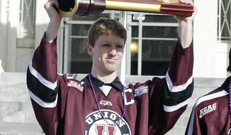 Union College team captain Mat Bodie celebrates his team's NCAA hockey championship, during a rally Thursday, April 17, 2014, in Schenectady, N.Y. Union defeated Minnesota last Saturday for its first national championship. (AP Photo/Mike Groll)