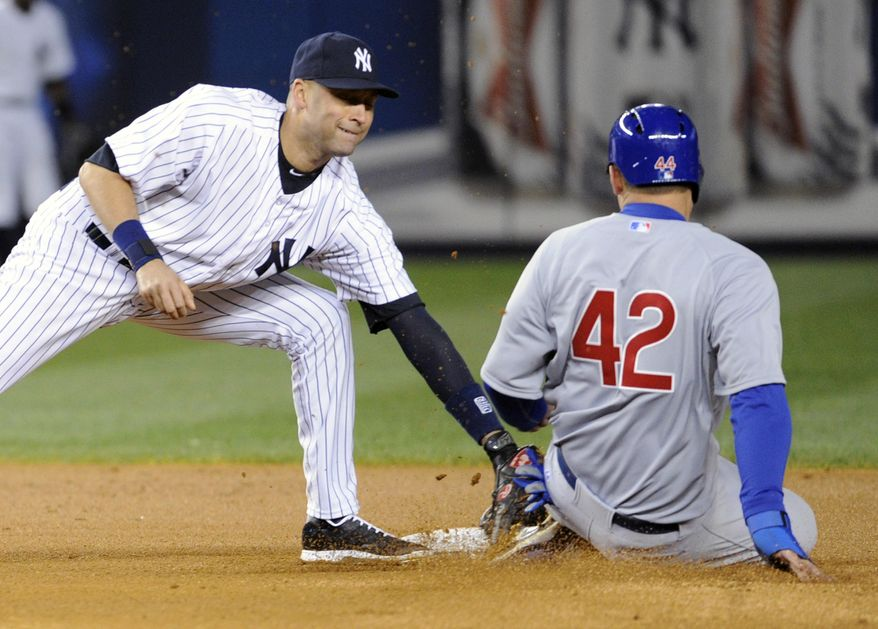 New York Yankees shortstop Derek Jeter, left, tags out Chicago Cubs' Anthony Rizzo who was attempting to steal second base during the fourth inning of Game 2 of an interleague baseball doubleheader on Wednesday, April 16, 2014, at Yankee Stadium in New York. (AP Photo/Bill Kostroun)