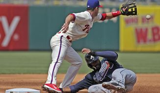 Atlanta Braves' Jason Heyward slides safe into third as Philadelphia Phillies' Jayson Nix waits for the ball in the third inning of a baseball game Thursday, April 17, 2014, in Philadelphia.  (AP Photo/H. Rumph Jr)