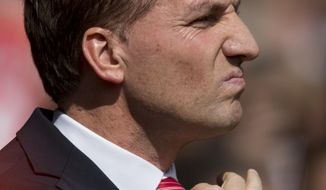 Liverpool's manager Brendan Rodgers adjusts his tie as he takes to the touchline before his team's English Premier League soccer match against Manchester City at Anfield Stadium, Liverpool, England, Sunday April 13, 2014. (AP Photo/Jon Super)