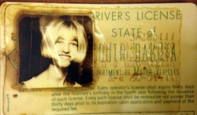 FILE - In this photo provided by the South Dakota Attorney Generals Office is  Cheryl Miller's driver's license that was found in a 1960 Studebaker pulled from a creek near Alcester, S.D. Miller and Pamella Jackson were last seen on May 19, 1971 driving to a gathering with classmates to celebrate the end of the school year. On April 15, 2014 authorities confirmed the 43-year-old mystery of the girls disappearance was solved and that the two 17-year-olds had died after driving into the creek. (AP Photo/South Dakota Attorney Generals Office, File)