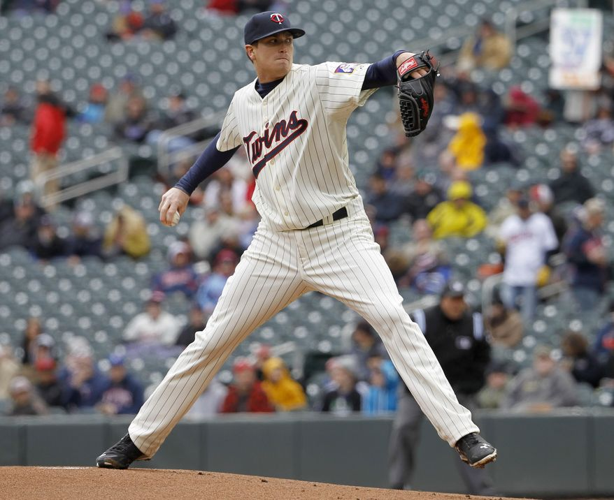 Minnesota Twins starting pitcher Kyle Gibson delivers to the Toronto Blue Jays during the first inning of the first baseball game of a doubleheader in Minneapolis, Thursday, April 17, 2014.  (AP Photo/Ann Heisenfelt)