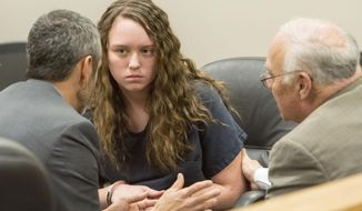 Defense attorney's Rhome Zabriske, left, and Dean Zabriskie, right,  visit with Meagan Grunwald, during  a recess in her preliminary hearing in Judge Darold McDade's courtroom in Provo, Utah on Thursday April 17, 2014.    Grunwald, the only surviving suspect from a highway chase and shootout with police, is facing 12 charges, including aggravated murder and attempted murder of Utah County Sheriff's Sgt. Cory Wride.   Her boyfriend, Jose Angel Garcia-Juaregui, 27, fatally shot Wride and injured another deputy during the crime spree, authorities said. Garcia-Juaregui died from wounds suffered in a shootout with Juab County deputies when they caught up to the pair south of Nephi. (AP Photo/The Salt Lake Tribune, Rick Egan, Pool)