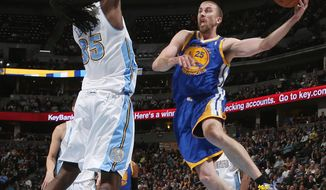 Golden State Warriors guard Steve Blake, right, prepares to pass around Denver Nuggets forward Kenneth Faried during the first quarter of an NBA basketball game in Denver on Wednesday, April 16, 2014. (AP Photo/David Zalubowski)