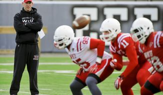 In this March 25, 2014 photo, Western Kentucky football coach Jeff Brohm watches over his first practice as head coach at Houchens-Smith Stadium, in Bowling Green, Ky. (AP Photo/Daily News, Alex Slitz)