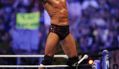 FILE- In this Sunday, April 3, 2011 file photo, WWE Superstar Randy Orton celebrates defeating CM Punk (not pictured) during WrestleMania XXVII at the Georgia Dome in Atlanta, Georgia on. World-famous WWE wrestlers such as John Cena, Shaemus and champion Randy Orton are in Saudi Arabia for three days of matches in the capital Riyadh. (Paul Abell/AP Images for WWE, File)