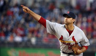 St. Louis Cardinals starting pitcher Adam Wainwright throws during the first inning of a baseball game against the Washington Nationals at Nationals Park on Thursday, April 17, 2014, in Washington. (AP Photo/Alex Brandon)