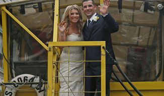 Boston Marathon bombing survivor Marc Fucarile and his bride, Jennifer Regan, wave from a Duck Boat as they leave after their wedding ceremony at Fenway Park in Boston, Thursday, April 17, 2014. Fucarile, a 35-year-old roofer, lost his right leg from above the knee in the bombing. (AP Photo/Elise Amendola)