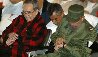 FILE - In this Nov. 26, 2002 file photo, Cuba's leader Fidel Castro, right, and Colombian Nobel laureate Gabriel Garcia Marquez check their watches during the inauguration of the first Cuban National Olympic games at Revolution Square in Havana, Cuba. Marquez died Thursday April 17, 2014 at his home in Mexico City.(AP Photo/Jose Goitia, File)