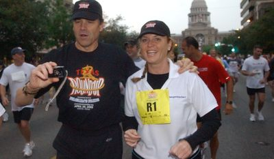 "Texas Gov. Rick Perry, center, takes a photo of himself and Britian's Duchess of York Sarah Ferguson, and spokesperson for Weight Watchers, as they run the 10K race at the ""Texas Round Up"" Saturday, April 30, 2005, in Austin, Texas. (AP Photo/Weight Watchers, Amber Novak)"