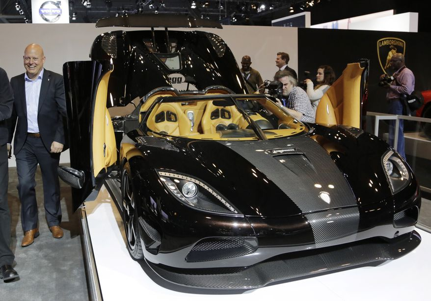 ** FILE ** Christian von Koenigsegg, left, founder of the Swedish car-maker  Koenigsegg Automotive AB, walks around his Agera R sports car at the New York International Auto Show, Thursday, April 17, 2014, in New York. (AP Photo/Mark Lennihan)