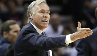 Los Angeles Lakers head coach Mike D'Antoni argues a call during the second half of an NBA basketball game against the San Antonio Spurs, Wednesday, April 16, 2014, in San Antonio. Los Angeles won 113-100. (AP Photo/Eric Gay)