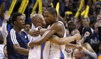 Oklahoma City Thunder forward Kevin Durant (35) embraces teammate Caron Butler, left, after the Thunder defeated the Detroit Pistons in an NBA basketball game in Oklahoma City, Wednesday, April 16, 2014. Oklahoma City won 112-111. (AP Photo/Sue Ogrocki)