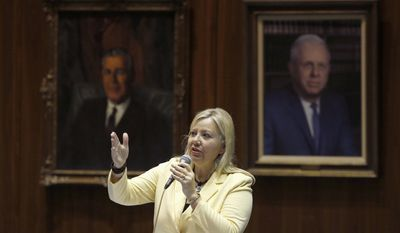 Rep. Debbie Lesko, R-Peoria, and sponsor of House Bill 2291, answers questions about an amendment to House Bill 2291, an expansion for Arizona's school-voucher program, before members vote on the measure at the Arizona Capitol on Thursday, April 17, 2014, in Phoenix. Key Republicans banded with Democrats to vote down House Bill 2291, which would have made another 100,000 to 120,000 low-income students eligible for the Arizona Empowerment Scholarship Accounts program. (AP Photo/Ross D. Franklin)