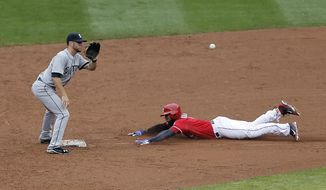 Texas Rangers' Elvis Andrus (1) steals second as Seattle Mariners second baseman Nick Franklin (6) catches the throw during the second inning of a baseball game, Thursday, April 17, 2014, in Arlington, Texas. (AP Photo/Brandon Wade)