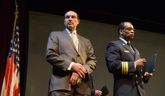 Mayor Vincent Gray, (D) and D.C. Fire & Emergency Medical Services Chief Kenneth Ellerbe awaitsgraduates of  Recruit Class 367 graduation at Gallaudet University in Northeast on April 17. Khalid Naji-Allah /Special to The Washington Times