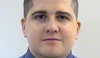 FILE - This undated photo provided by the Middlesex District Attorney's Office shows Massachusetts Institute of Technology Police Officer Sean Collier, 26, of Somerville, Mass. Investigators said Collier was shot to death Thursday, April 18, 2013 on the school campus in Cambridge, Mass., by Boston Marathon bombing suspects Tamerlan and Dzhokhar Tsarnaev in a botched attempt to obtain his gun several days after the twin explosions. Collier will be remembered on the first anniversary of his death in a ceremony at MIT Friday morning, April 18, 2014. (AP Photo/Middlesex District Attorney's Office, File)