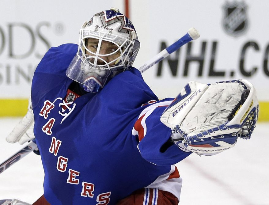 FILE - In this March 24, 2014 file photo, New York Rangers goalie Henrik Lundqvist makes a save during the first period of the NHL hockey game against the Phoenix Coyotes, in New York. Lundqvist already owns the club records for most career wins and shutouts. Both were accomplished this year in a most successful season. However, there is one key thing missing from the star goalie's resume: a Stanley Cup title. (AP Photo/Seth Wenig, File)