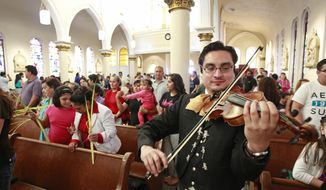 FOR RELEASE SUNDAY, APRIL 20, 2014, AT 12:01 A.M. CDT. Nelson Ulloa performs with others members of Mariachi Norteño during the mariachi Mass at St Joseph's Catholic Church, 1505 Kane St, Sunday, April 13, 2014, in Houston. (AP Photo/ Houston Chronicle, Melissa Phillip)