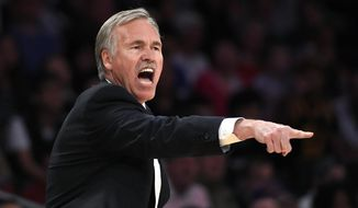 Los Angeles Lakers head coach Mike D'Antoni gestures to his team during the second half of an NBA basketball game against the Memphis Grizzlies, Sunday, April 13, 2014, in Los Angeles. The Grizzlies won 102-90. (AP Photo/Mark J. Terrill)