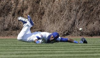 Chicago Cubs left fielder Junior Lake can' t make the catch on a double hit by Cincinnati Reds' Billy Hamilton during the fifth inning of a baseball game in Chicago, Friday, April  18, 2014. (AP Photo/Nam Y. Huh)