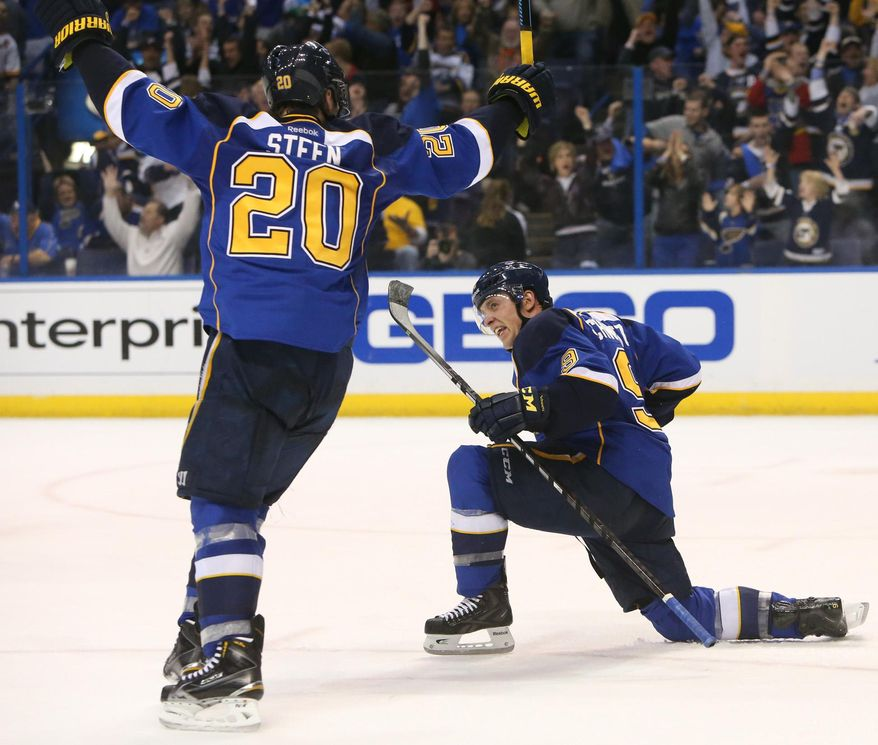 St. Louis Blues center Jaden Schwartz, right, reacts after scoring to pull the Blues into a tie with the Chicago Blackhawks during the closing minutes of the third period of Game 1 of an NHL hockey opening-round playoff series, Thursday, April 17, 2014, in St. Louis. At left is teammate Alexander Steen. (AP Photo/St. Louis Post-Dispatch, Chris Lee) EDWARDSVILLE OUT  ALTON OUT