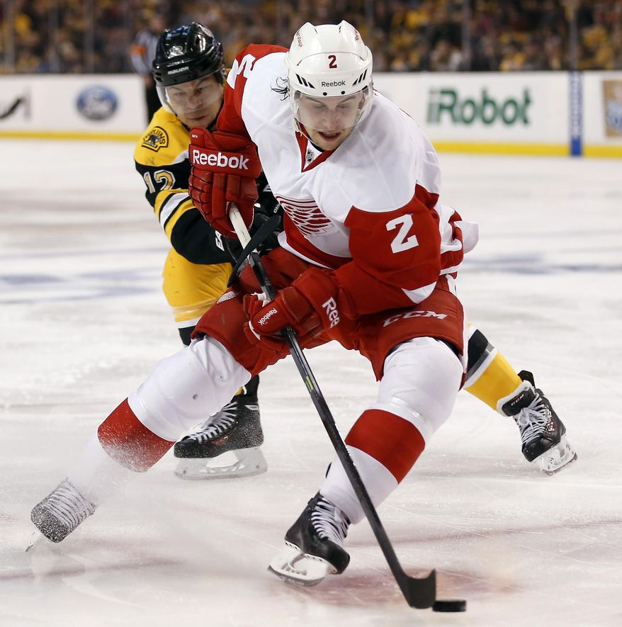 Detroit Red Wings defenseman Brendan Smith (2) tries to get away from Boston Bruins' Jarome Iginla during the second period of Game 1 of a first-round NHL playoff hockey series, in Boston on Friday, April 18, 2014. (AP Photo/Winslow Townson)