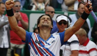 David Ferrer of Spain celebrates after defeating Rafael Nadal of Spain during their quarterfinals match of the Monte Carlo Tennis Masters tournament in Monaco, Friday, April 18, 2014. Ferrer won 7-6 6-4. (AP Photo/Michel Euler)