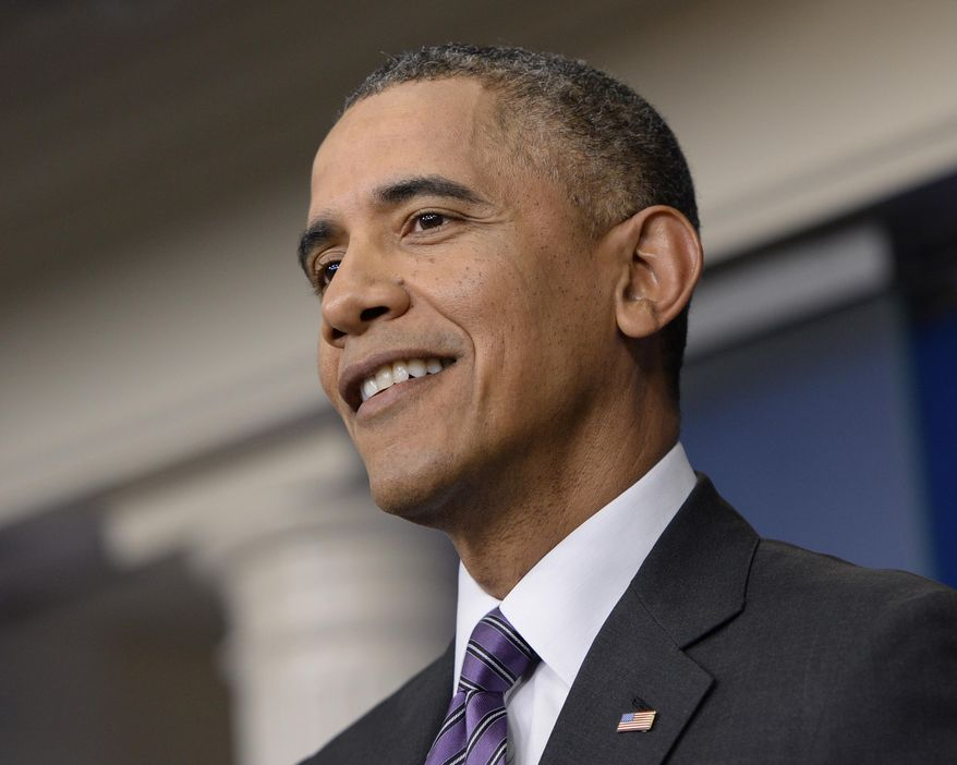 President Barack Obama smiles as he speaks in the briefing room of the White House in Washington, Thursday, April 17, 2014. The president spoke about health care overhaul and the situation in Ukraine.  (AP Photo/Susan Walsh)