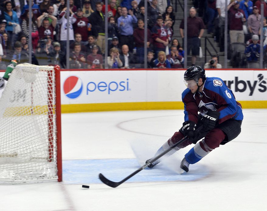 Colorado Avalanche defenseman Erik Johnson (6) saves the empty net goal by the Minnesota Wild during the third period in Game 1 of an NHL hockey first-round playoff series on Thursday, April 17, 2014, in Denver. (AP Photo/Jack Dempsey)