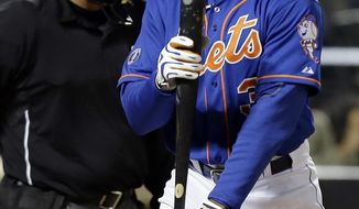 New York Mets' Curtis Granderson reacts after striking out during the sixth inning of a baseball game against the Atlanta Braves, Friday, April 18, 2014, in New York. (AP Photo/Frank Franklin II)
