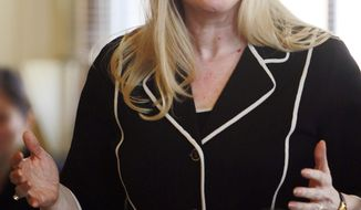 In this April 17, 2014 photo, state Sen. Donna Soucy speaks in favor of repealing the state's death sentence in Concord, N.H. The senate later voted 12-12, which kept the century old death sentence on the books. (AP Photo/Jim Cole)