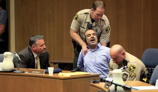 Murder suspect Kassim Alhimidi reacts to being found guilty for the murder of his wife Shaima Alawadi, Thursday April 17, 2014. Alhimidi shook his head as the verdict was read Thursday. He was charged with murdering his 32-year-old wife, Shaima Alawadi, in El Cajon, home to one of the largest enclaves of Iraqi immigrants in the U.S. (AP Photo/John Gastaldo,Pool)