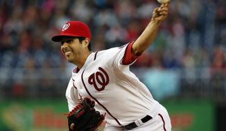 Washington Nationals starting pitcher Gio Gonzalez throws during the first inning of a baseball game against the St. Louis Cardinals at Nationals Park, Friday, April 18, 2014, in Washington. (AP Photo/Alex Brandon)