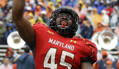 Maryland running back Brandon Ross reacts after scoring a touchdown in the first half of an NCAA college football game against Virginia in College Park, Md., Saturday, Oct. 12, 2013. (AP Photo/Patrick Semansky)