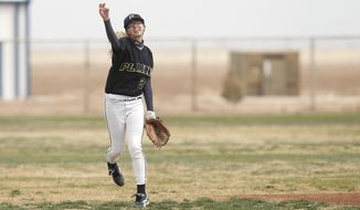 ADVANCE FOR MONDAY, APRIL 21, 2014 - Plains' Alyx Henderson throws during their baseball game in Smyer, Texas, Saturday, April 5, 2014. (AP Photo/Lubbock Avalanche-Journal, Stephen Spillman) ALL LOCAL TV OUT