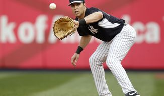 New York Yankees first baseman Mark Teixeira, who is on the disabled list, takes ground balls before a baseball game against the Boston Red Sox at Yankee Stadium in New York, Sunday, April 13, 2014.  (AP Photo/Kathy Willens)