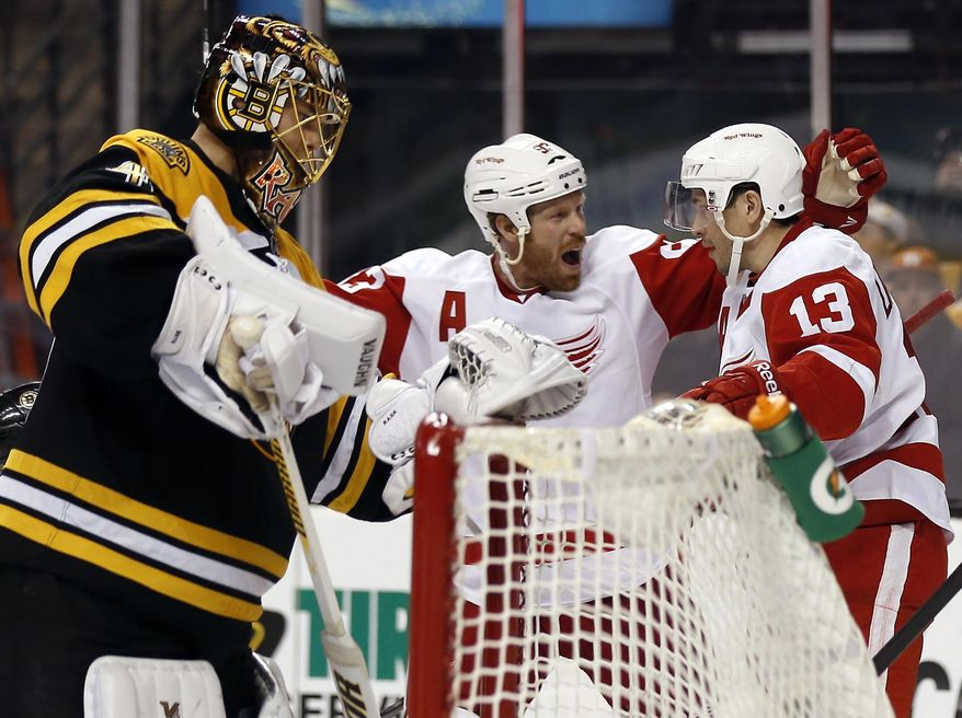 Detroit Red Wings' Pavel Datsyuk (13) is congratulated by teammate Johan Franzen after scoring against Boston Bruins goalie Tuukka Rask, left, during the third period of Detroit's 1-0 win in Game 1 of a first-round NHL playoff hockey series, in Boston on Friday, April 18, 2014. (AP Photo/Winslow Townson)