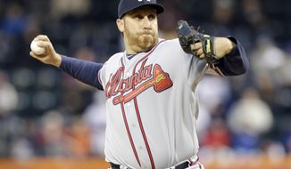 Atlanta Braves' Aaron Harang delivers a pitch during the first inning of a baseball game against the New York Mets, Friday, April 18, 2014, in New York. (AP Photo/Frank Franklin II)