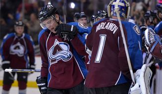 Colorado Avalanche center Paul Stastny (26) is congratulated by Colorado Avalanche goalie Semyon Varlamov (1) from Russia after scoring a goal against the Minnesota Wild  to tie the game and send it to overtime during the third period in Game 1 of an NHL hockey first-round playoff series on Thursday, April 17, 2014, in Denver. (AP Photo/Jack Dempsey)