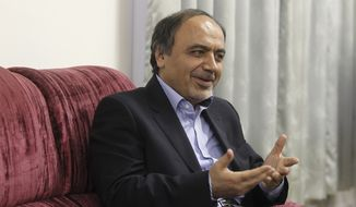 This Feb. 6, 2014 photo, provided by the office of the Iranian President, shows Hamid Aboutalebi, an Iranian diplomat, who was recently named as Iran's ambassador to the United Nations, speaking in his office in Tehran, Iran. President Barack Obama has signed legislation aimed at blocking Iran's chosen ambassador to the United Nations but says he's only treating it as guidance. The unusual legislation bars anyone from entering the U.S. as a U.N. representative if they've engaged in espionage or terrorist activity and still pose a threat to U.S. security. It's aimed at blocking Hamid Aboutalebi, linked to the 1979 takeover of the U.S. embassy in Tehran. (AP Photo/Iranian Presidency Office, Mohammad Berno)