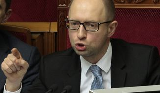 Ukrainian Prime Minister Arseniy Yatsenyuk speaks to lawmakers during a session at the Ukrainian parliament in Kiev, Ukraine, Friday, April 18, 2014. Pro-Russian insurgents in Ukraine's east who have been occupying government buildings in more than 10 cities said Friday they will only leave them if the interim government in Kiev resigns. (AP Photo/Sergei Chuzavkov)
