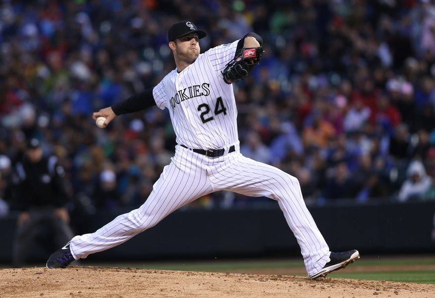Colorado Rockies starting pitcher Jordan Lyles works against the Philadelphia Phillies in the fourth inning of a baseball game in Denver on Saturday, April 19, 2014. (AP Photo/David Zalubowski)