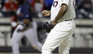 New York Mets relief pitcher Jose Valverde (47) reacts as Atlanta Braves' Justin Upton heads to home plate after hitting a three-run home run during the ninth inning of a baseball game Saturday, April 19, 2014, in New York. (AP Photo/Frank Franklin II)